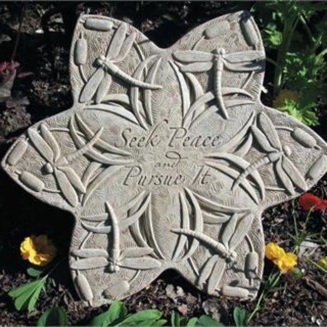 """Dragonfly Stepping Stone - """"These dragonflies create a textured pattern unlike any other stepping stone. Being pretty isn't good enough, there is also a meaningful verse sculpted into the center. Use as a stepper, or hang on a wall to accent a fence or deck.  Verse reads: """"""""Seek Peace And Pursue It""""""""  Image is Natural, other options are Aged, Green, Terra Cotta and Designer White   Dimensions: 15.50"""