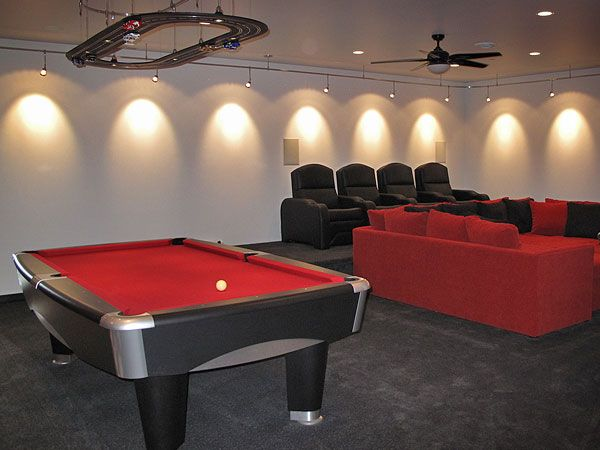 Modern man caves designs griots garage red pool table with modern man caves designs griots garage red pool table with overhead track lighting aloadofball Choice Image