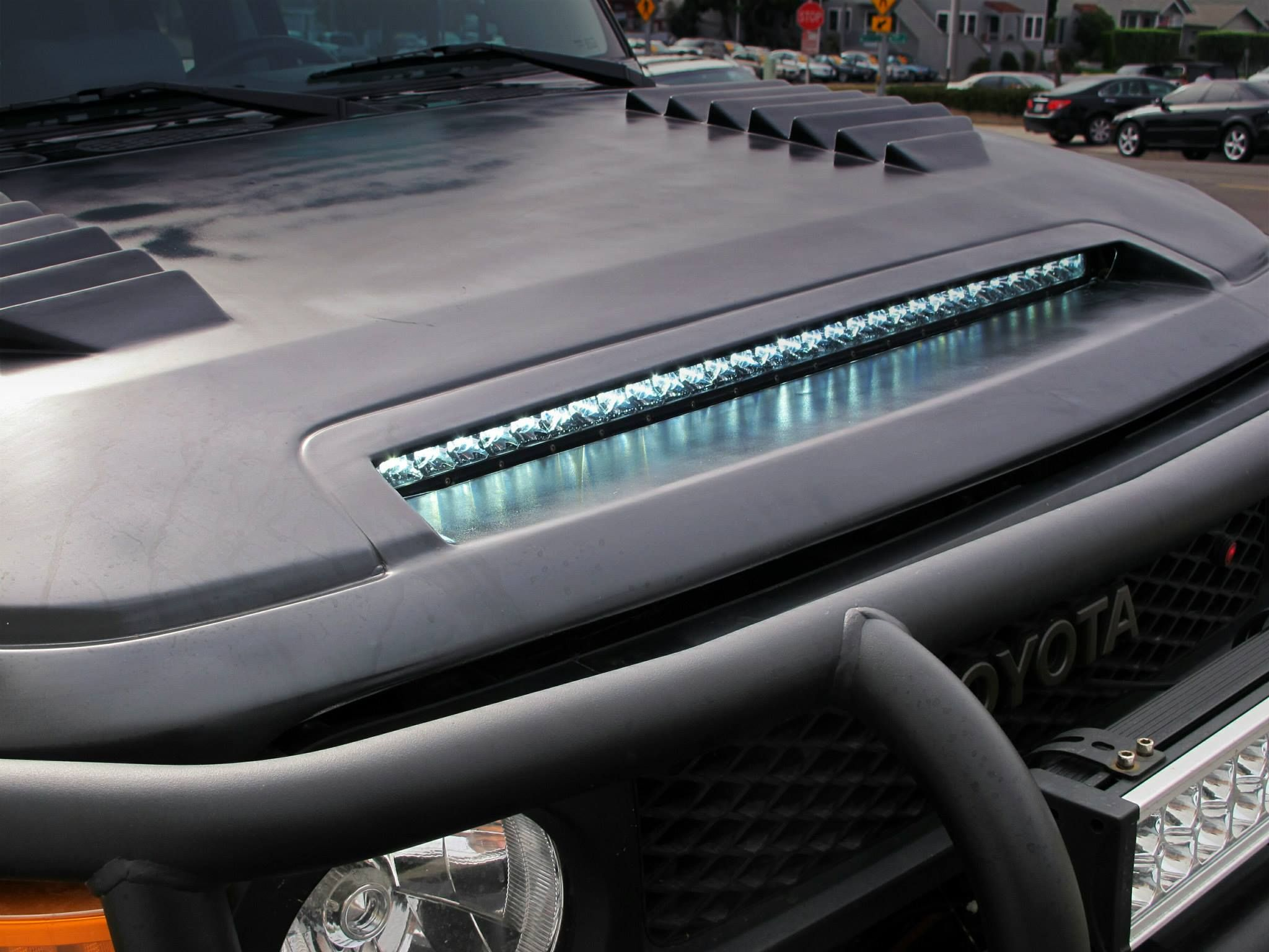 Toyota fj vented aftermarket hood w integrated rigid light spectre toyota fj cruiser
