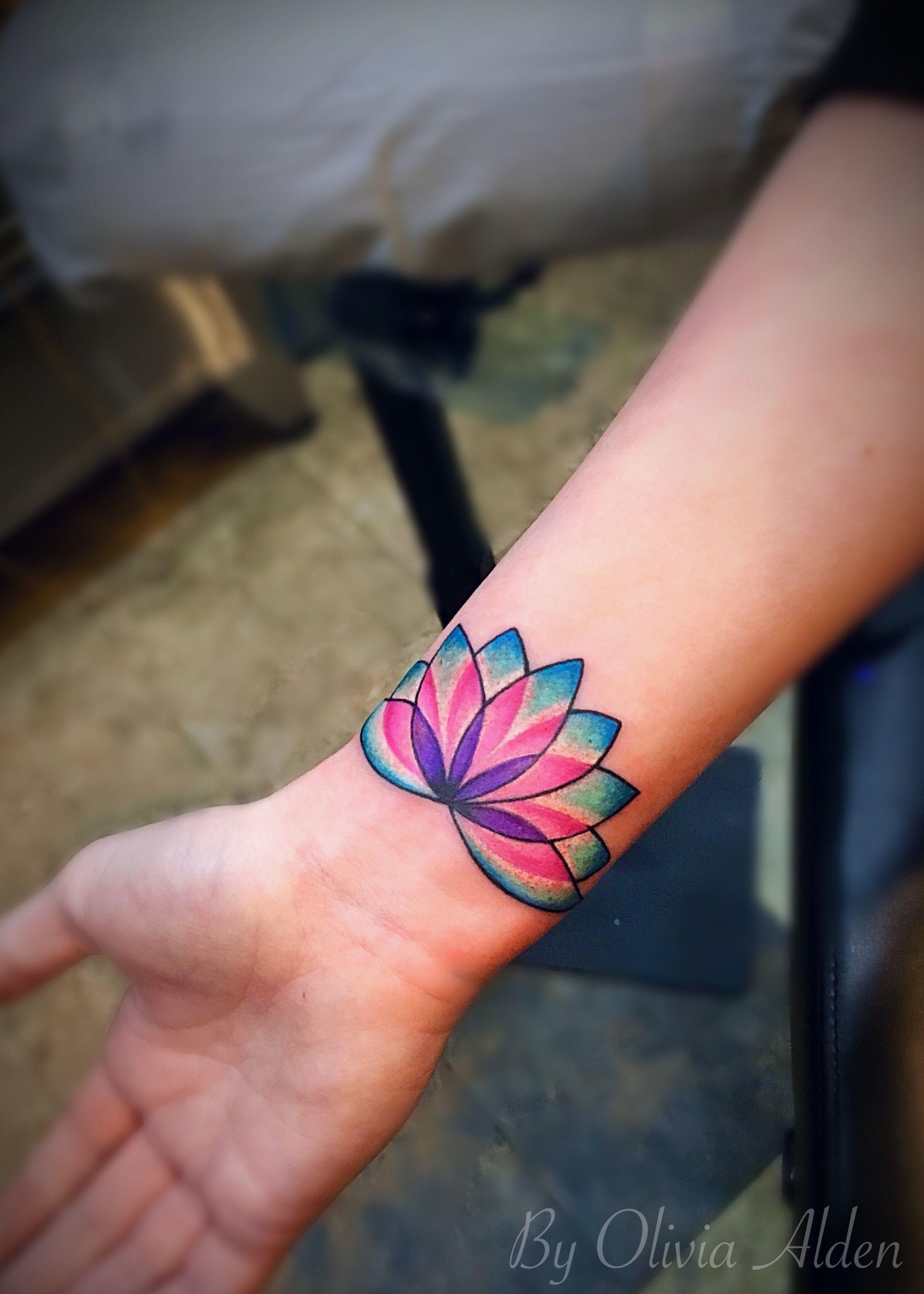 Beautiful multi toned colorful lotus flower womans wrist tattoo beautiful multi toned colorful lotus flower womans wrist tattoo river city tattoo wrist tattoos izmirmasajfo