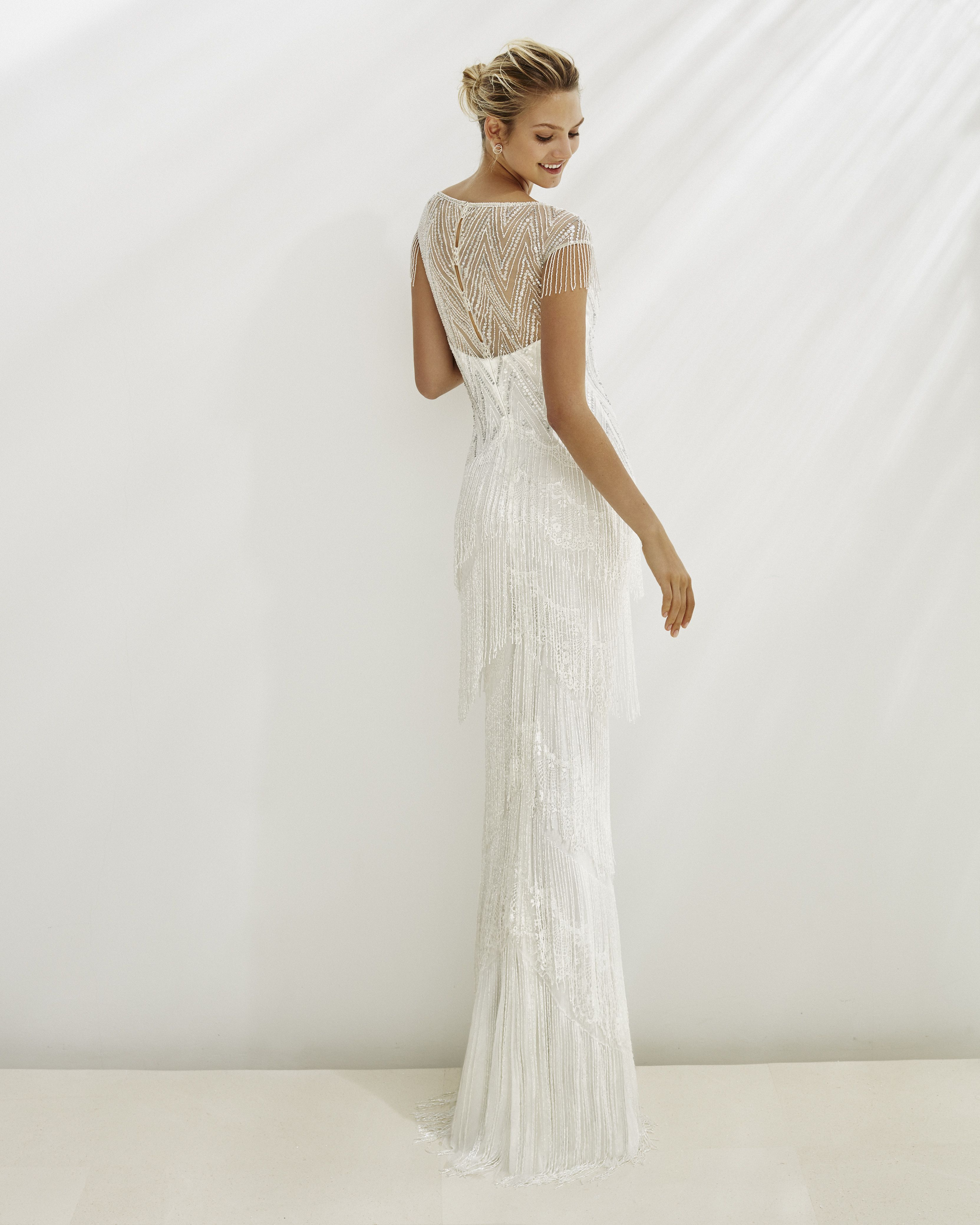 Sheath-style wedding dress in beaded lace. V-neckline and fringe. Available a6d2f4c05dbb