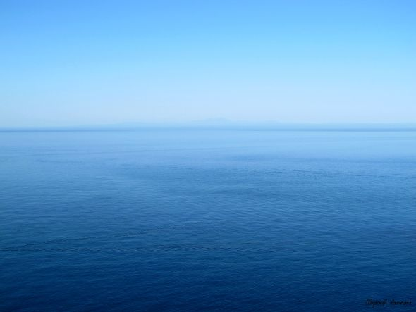 Sea and sky, shades of blue .  View of the horizon (and California coast) from Catalina Island, California.