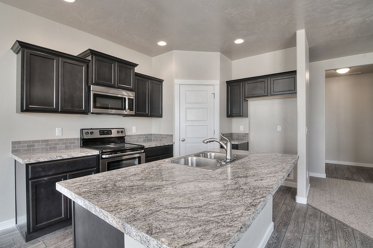 Create Contrast In Your Dream Kitchen With Dark Twilight Cabinets And Light Countertops Kitchen Design Small Expresso Kitchen Cabinets Kitchen Remodel