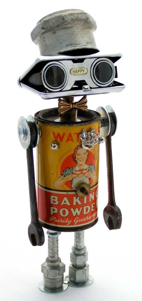 """""""The Happy Homemaker"""" Height: 14"""" Principal Components: Baking powder tin, opera glasses, """"Dodge Brothers"""" hubcap, wrenches, hose fittings, clock gear, brooch"""