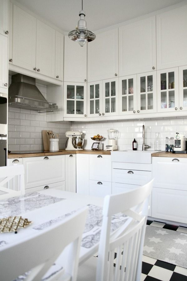 Checked floor + white cabinets + subway tile + farmhouse sink ...