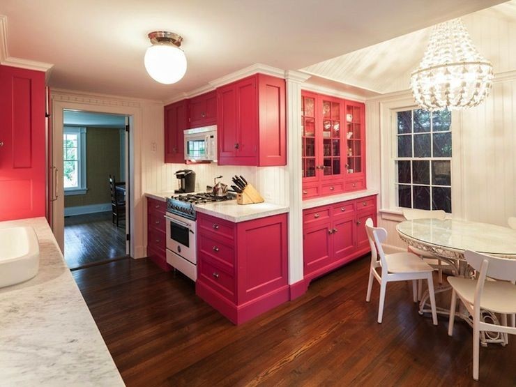 Fun Kitchen Featuring Hot Pink Cabinets Paired With Carrera Marble  Countertops And Beadboard Backsplash.