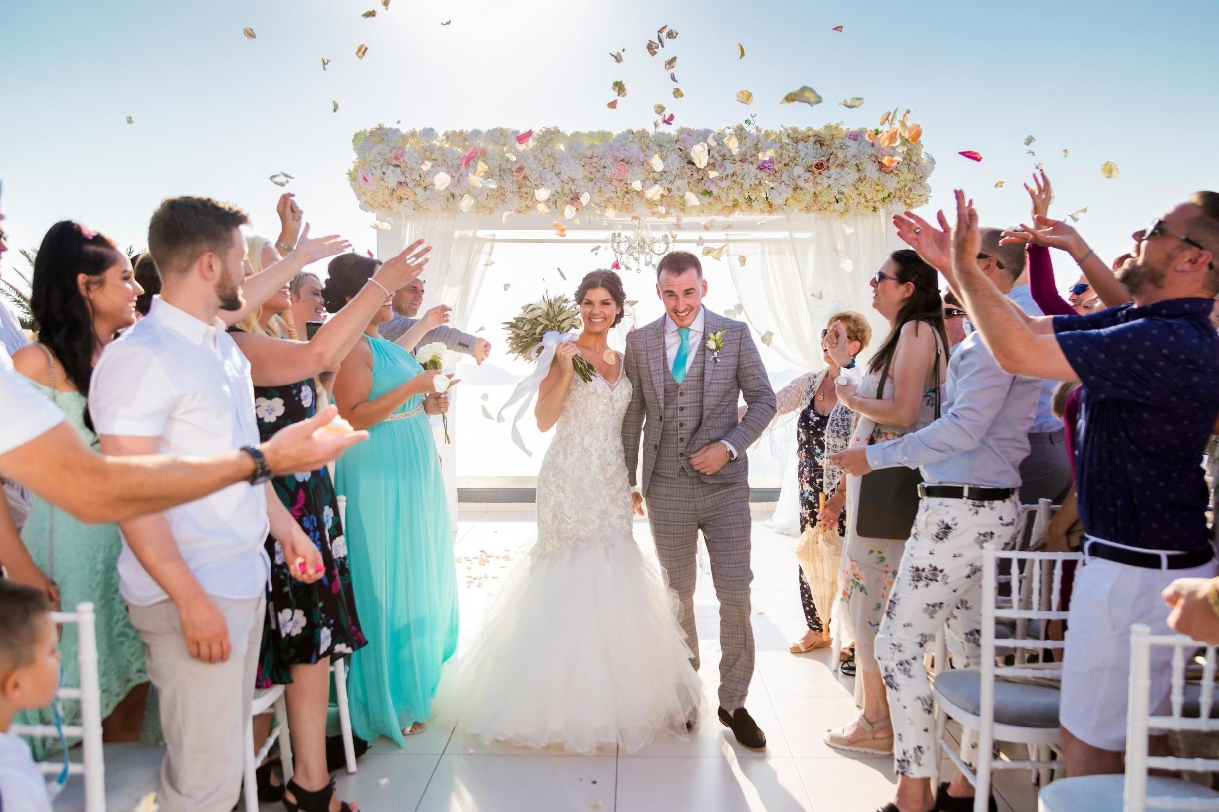 I like the flower altar and the flowers in the air. | Groom ...