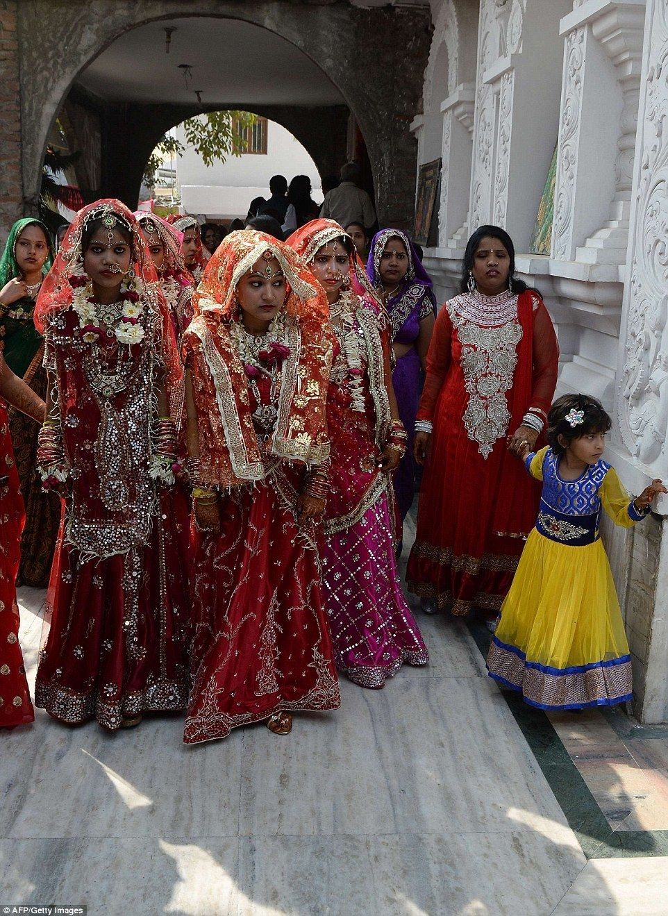 Touching pictures of Indian 12 couples tying the knot in group ...