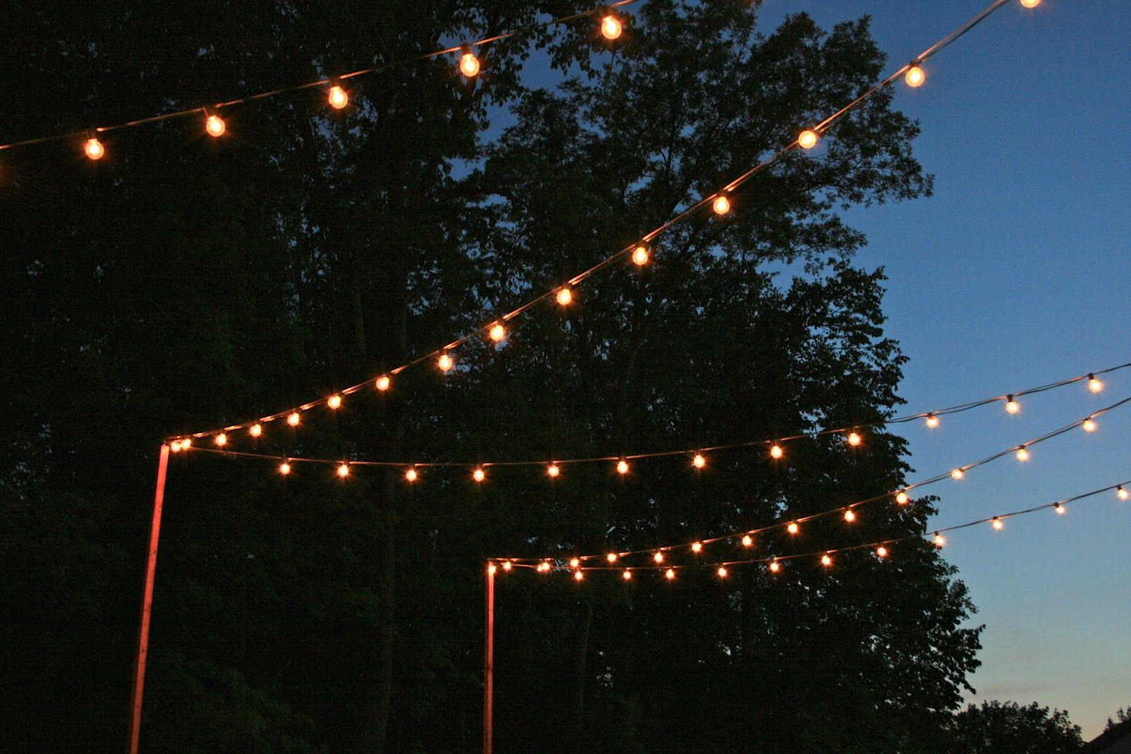 Cafe lights strung between house and deck railing back yard astonishing perfect and delightful cafe lighting ideas with simple outdoor lighting string idea mozeypictures Image collections