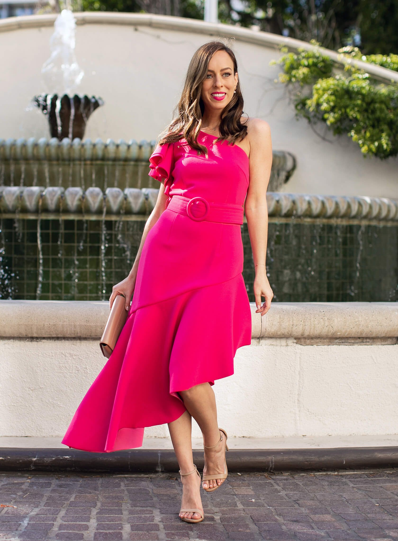 Sydne Style wears elliat pink belted dress for summer