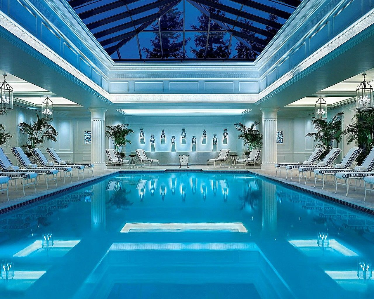Enchanting Indoor Swimming Pool In Luxurious Hotel Showing Rectangular Shaped Pool And Lovely Lounge Chairs And Ro Indoor Pool Indoor Swimming Pools Hotel Pool