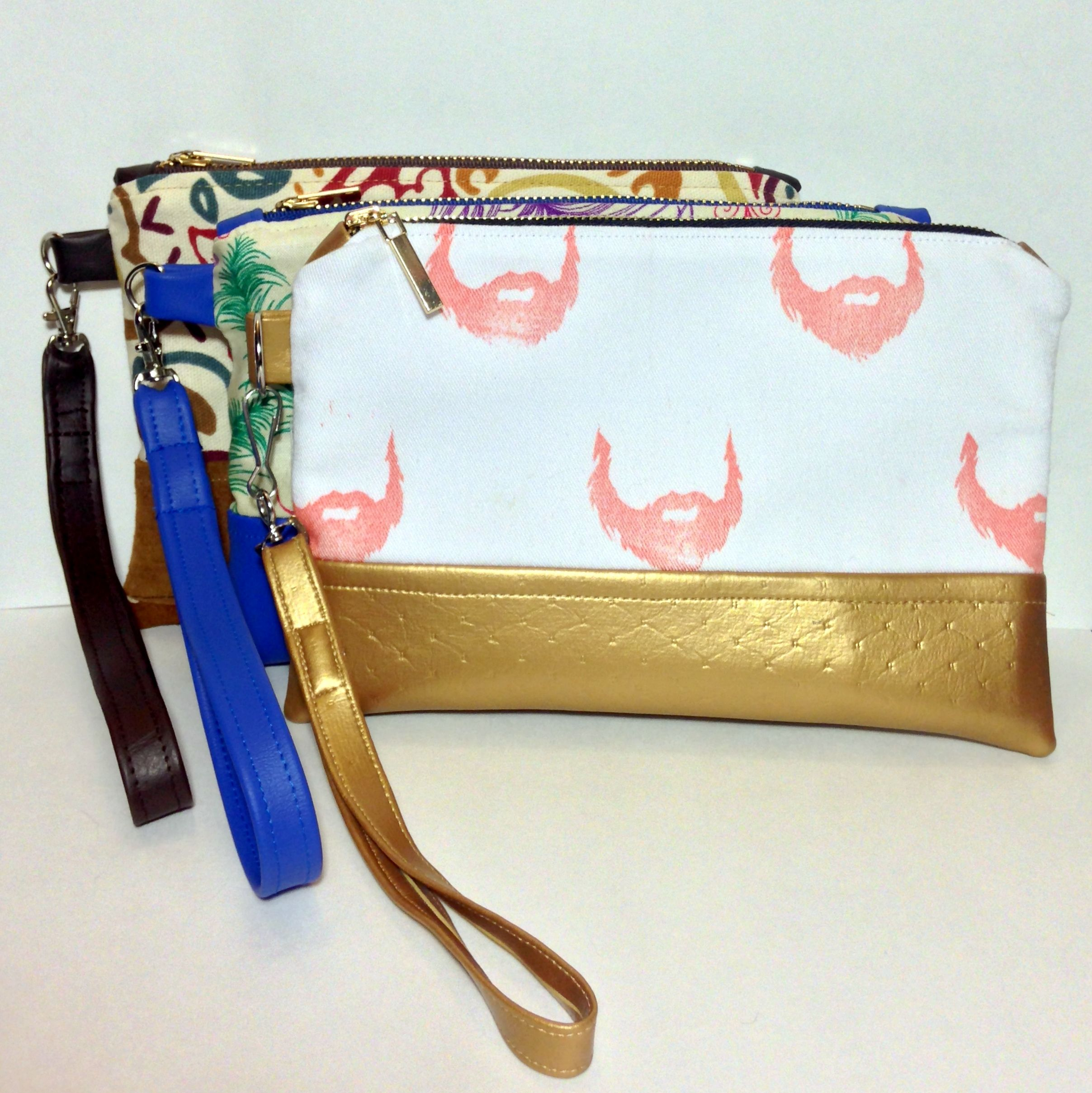 Handmade vinyl and leather bottom clutches with handmade removable straps