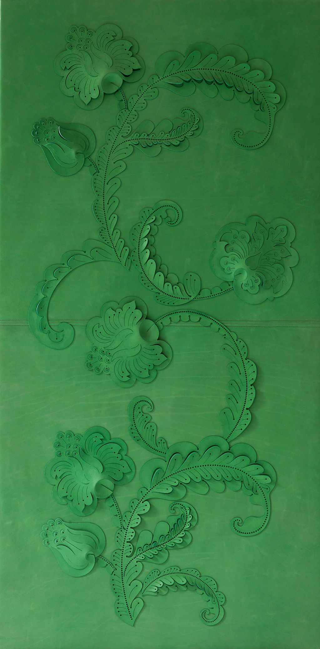 A decorative leather wall panel made from hand cut and sculpted leather with a damask inspired pattern from vintage woven textiles
