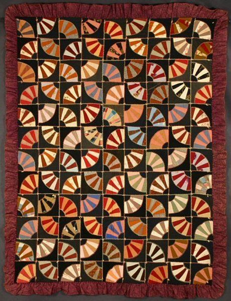 """Victorian Wool Fans Quilt: Circa 1890; Pennsylvania Miniature Fans are well scaled to this small size quilt ( 47"""" x 62""""). Ruffled border is the quintessential Victorian touch. Outlines nicely embroidered. Very slight damage to one block, visible only with close examination; slight color loss in another but overall, in better than very good condition. Circa 1890; Pennsylvania origin."""