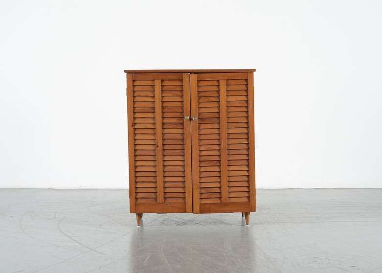 A Mid Century Pine Cabinet. This Cabinet Sits On Short, Tapered Legs.