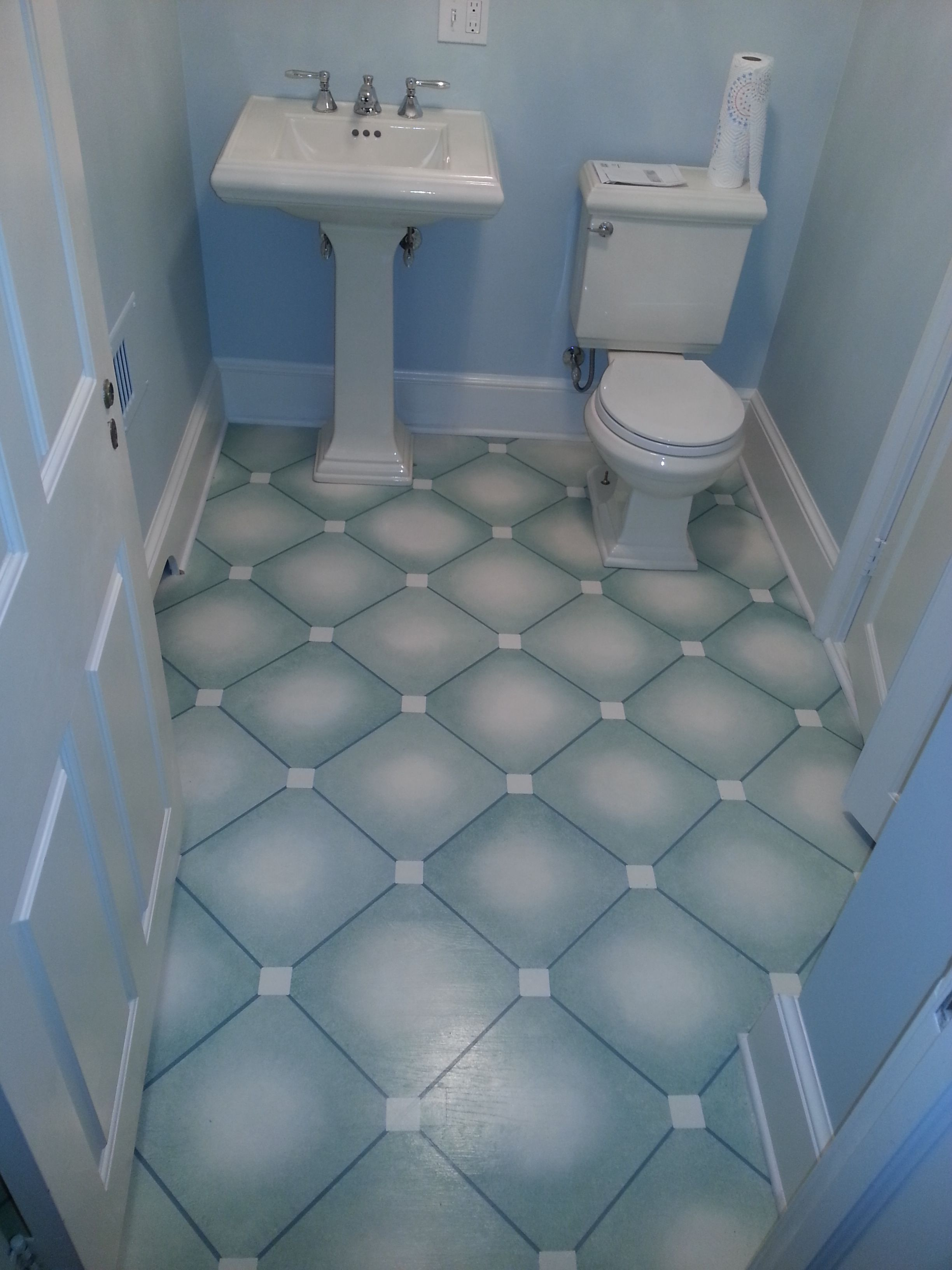 Bathroom-hand painted floor done on hardwood flooring by John Q Decorative  Finishes