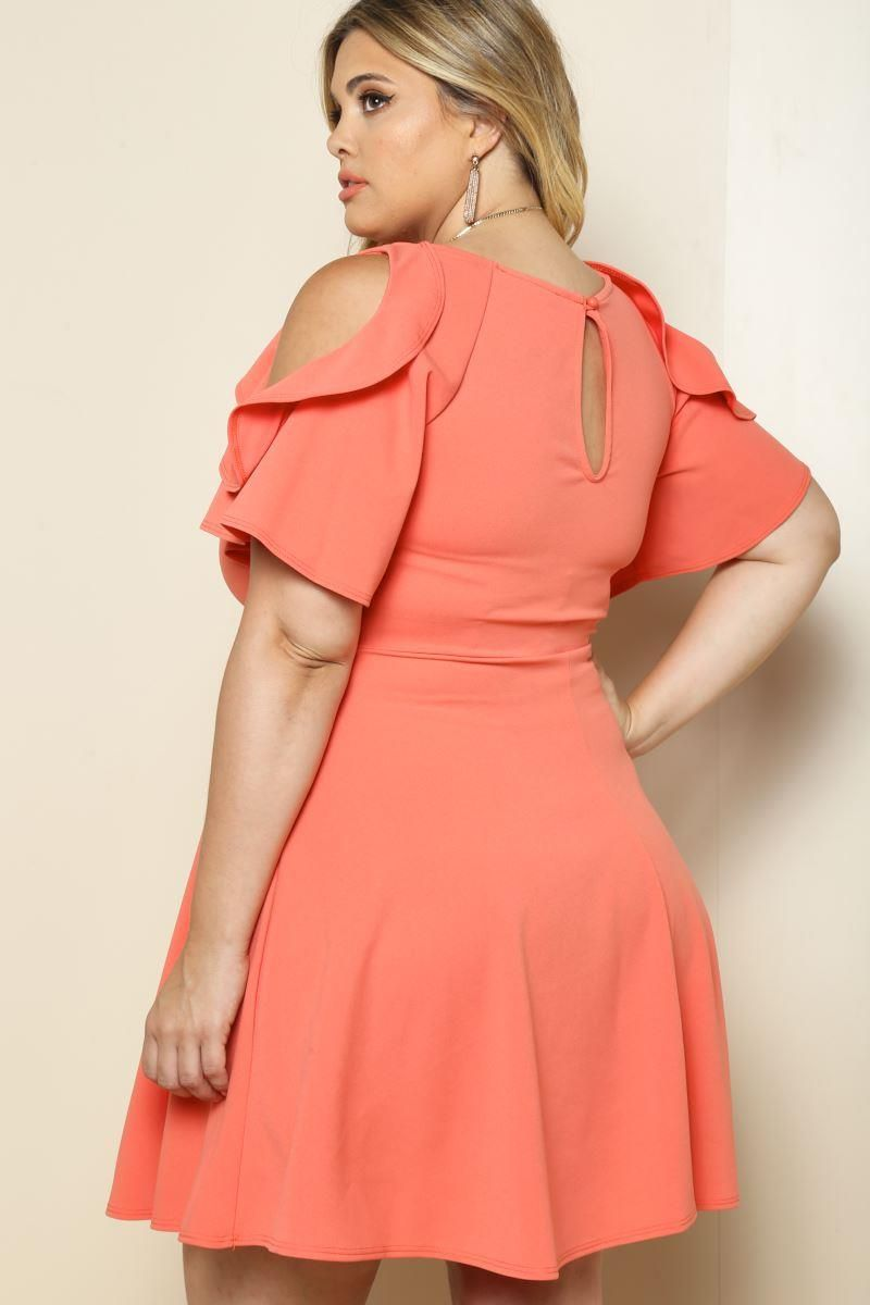 4501ae76a06ad A charming plus size cocktail dress with a cute styling that creates an  attractively cheerful look