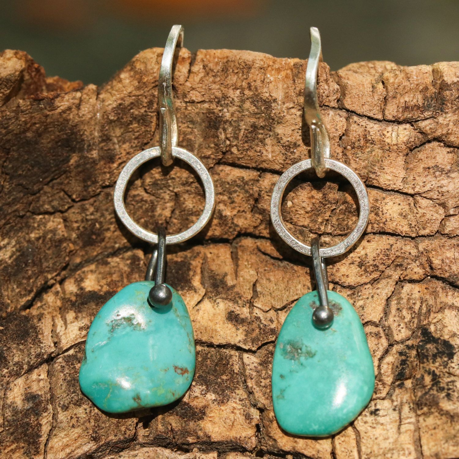Blue turquoise earrings in freeform with silver matte finished loops and sterling silver hooks on the top