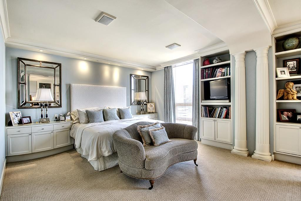 Master bedroom with crown molding, carpet, built-in ...