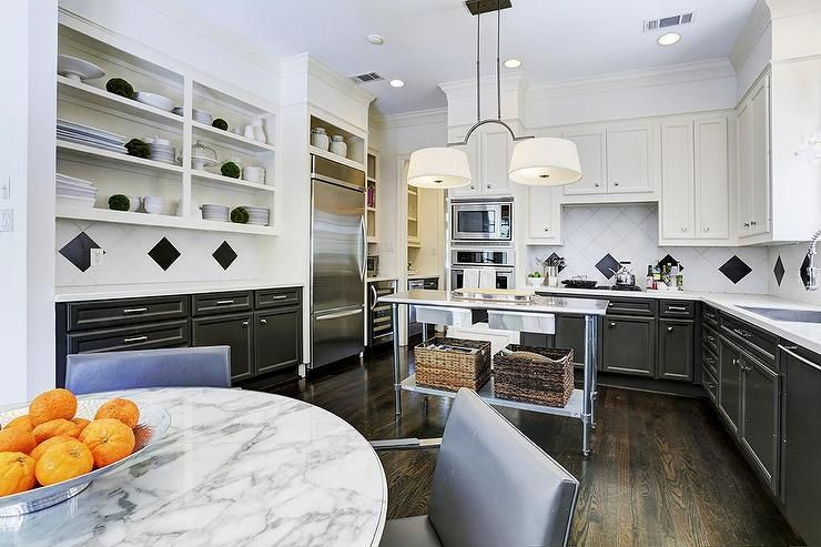Black And White Kitchen Boasts Tuxedo Cabinets Upper Lower