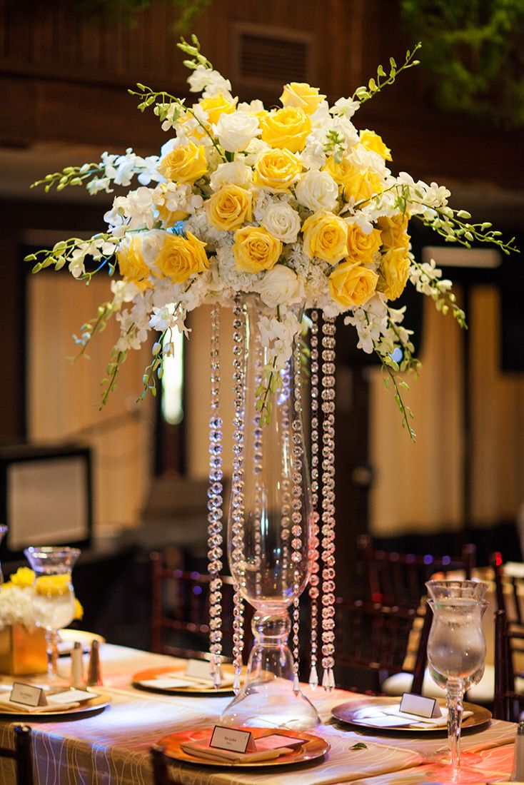 Wedding decorations yellow and gray  Tall centerpiece with orchidsg  detalles  Pinterest