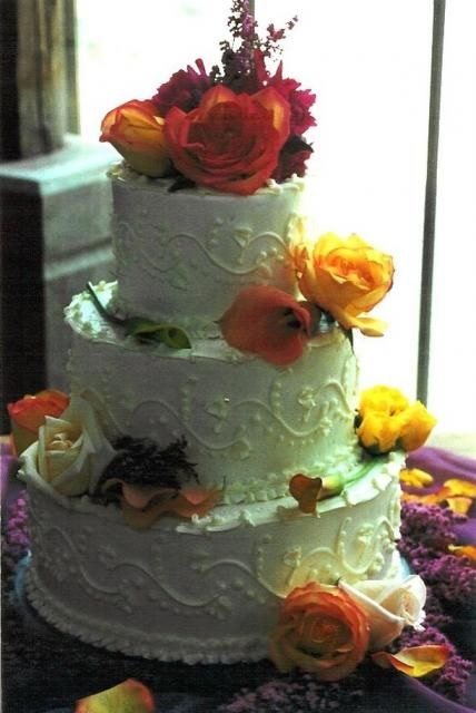 Big Wedding Cake With Fresh Flowers In Bright Summer Colors