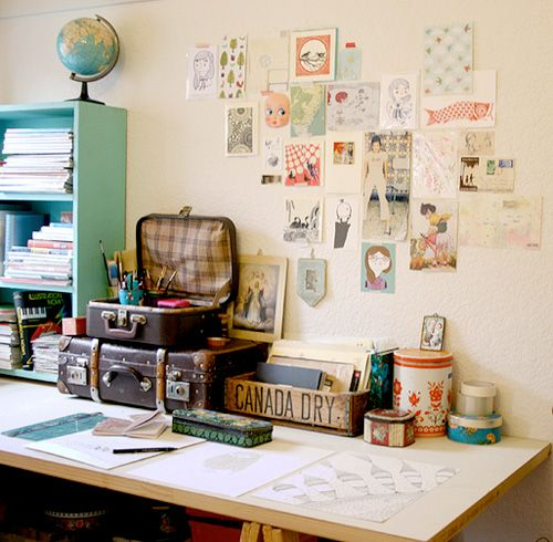 I love the use of vintage suitcases as storage devices in this home office - nice looking and functional!