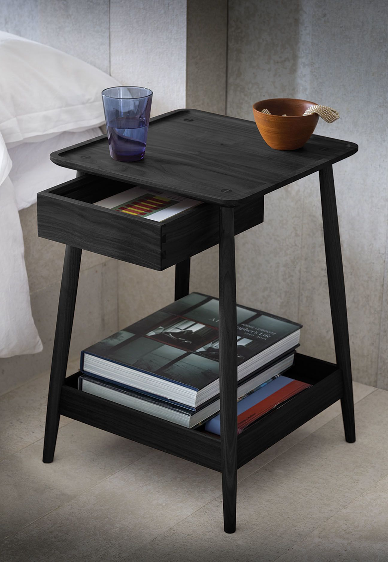 A Contemporary Bedside Table In Black Stained Ash With A Dovetailed Drawer Turned Legs And A Lipped Bottom Tray Furniture Black Bedside Table Coffee Table