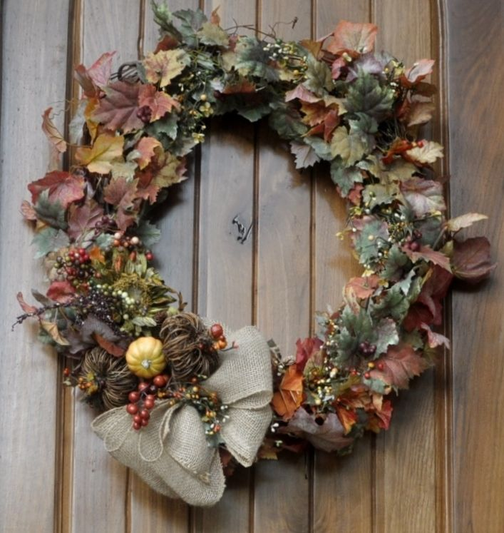 This started with a simple grapevine wreath...after adding a couple of inexpensive garlands and a few fall pics