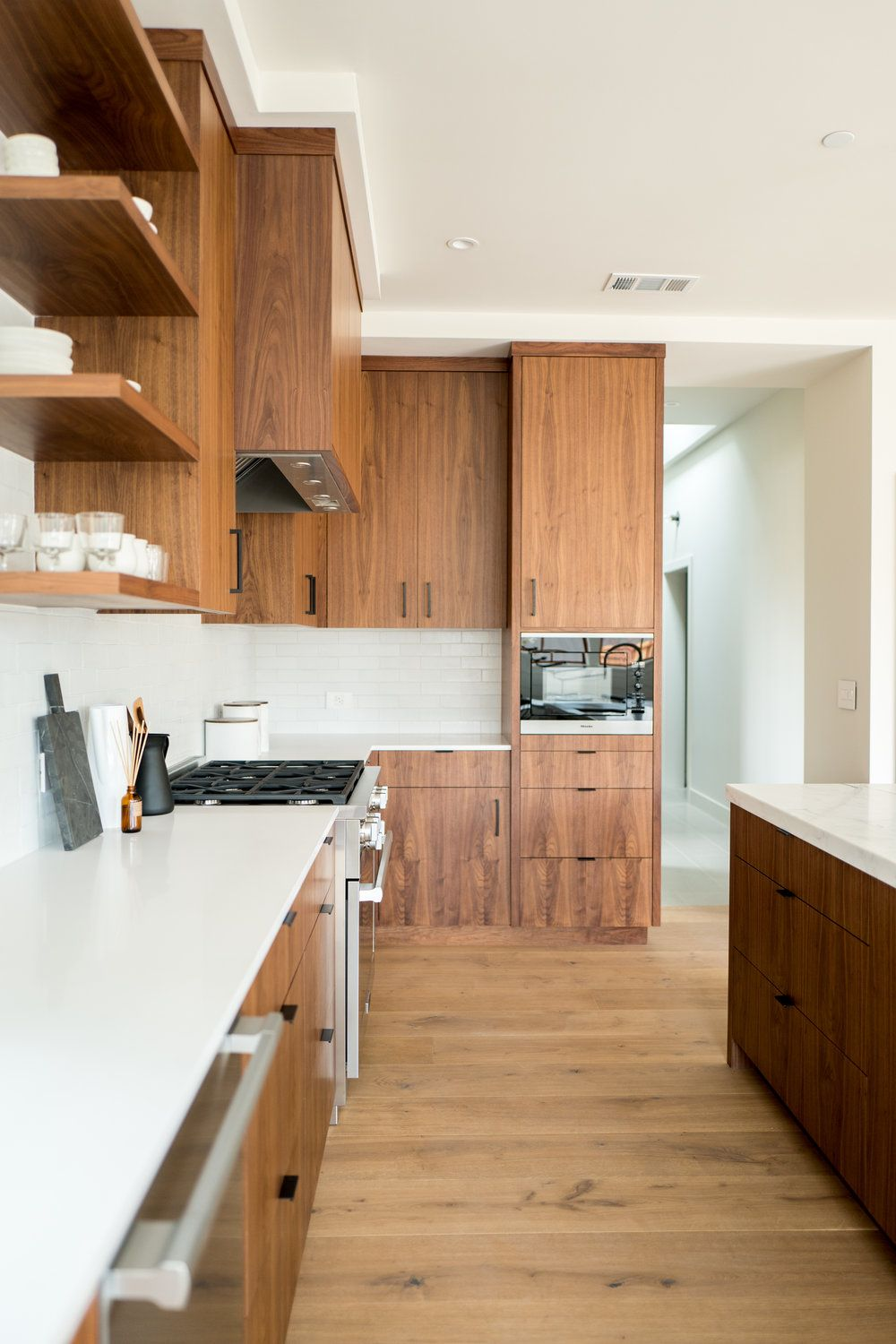 Mid Century Style Cabinetry In The Kitchen With Walnut Cabinets Modern Ledge Pulls Hardware Wood Cabinets With Walnut Cabinets Walnut Kitchen Wood Cabinets
