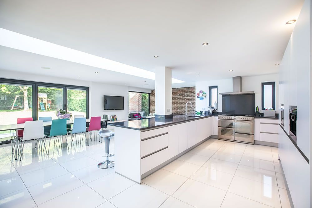 Contemporary white kitchen created by l&e lofts and extensions in
