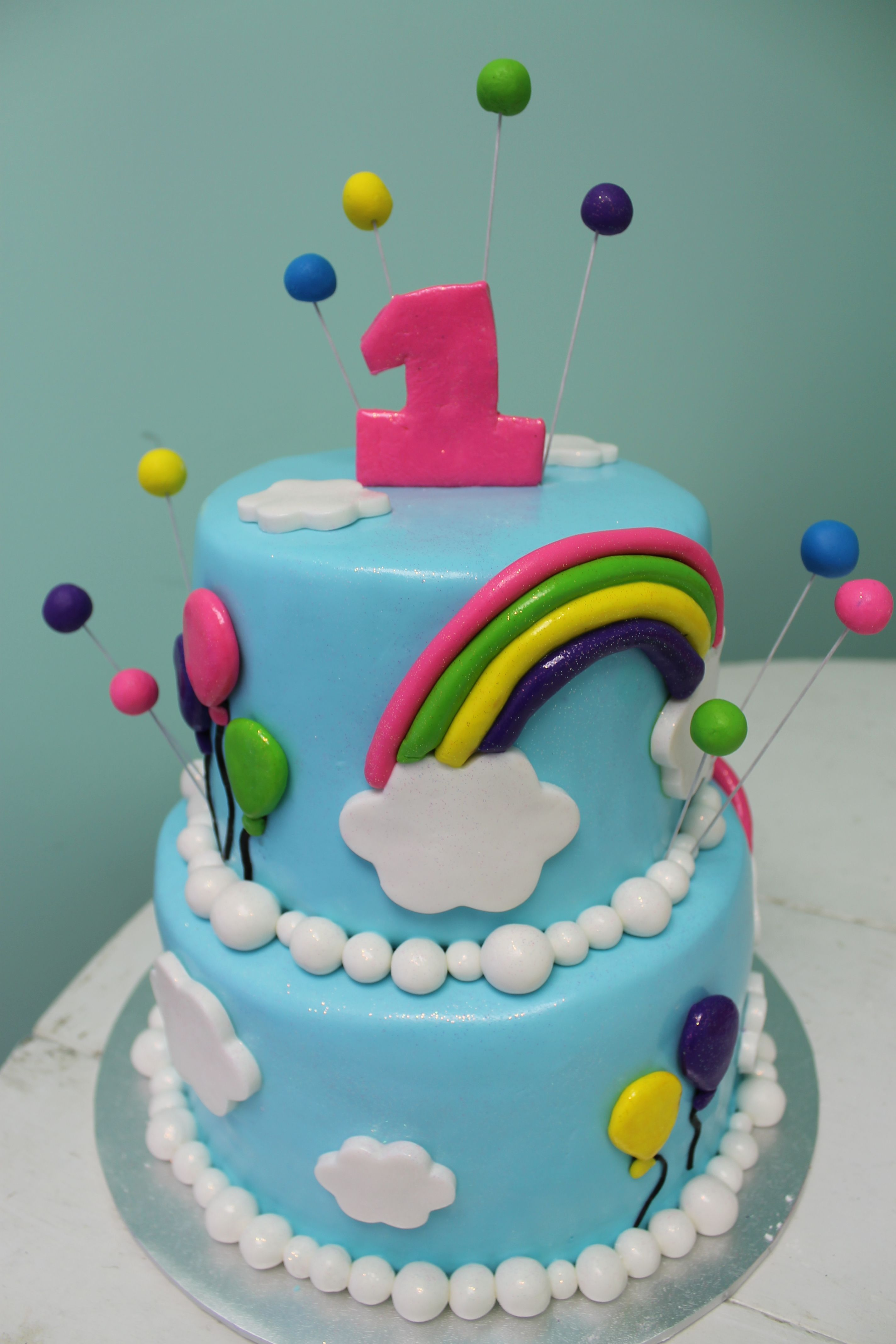 Rainbows and balloons for a 1st birthday Pink Ribbon Bakerys