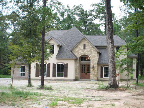 Stone Home With Cedar Shutters | Paul Meyer Premier Series Custom Home at