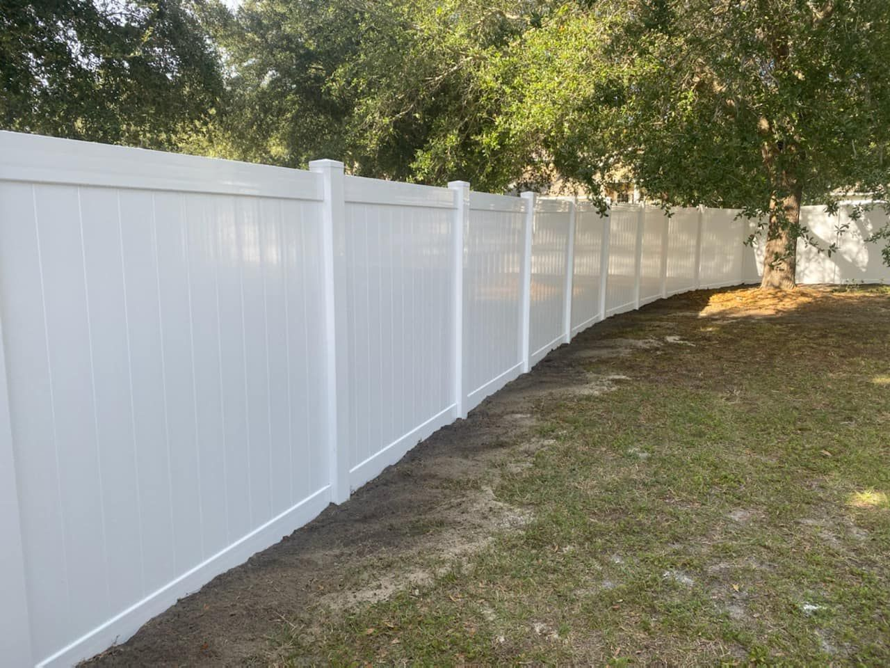 Classic White Vinyl Fence Designed Installed By Mossy Fence