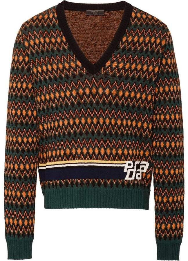 c3ff87e56bc6 This bottle green wool and cashmere sweater features a deep V neck ...