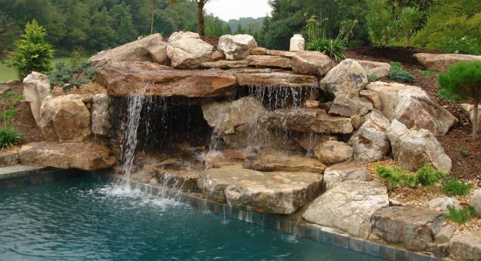 Swimming pool natural looking swimming pool designs with for Natural rock swimming pools