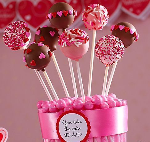Valentines Cake Pop Bouquet: Kids can help decorate these treats for Dad. When they're done decorating, make a cake pops bouquet by arranging them in a clear container with pink candy sticks, gumballs, ribbon and a favor sticker on the front with a cute phrase. #cakepopbouquet Valentines Cake Pop Bouquet: Kids can help decorate these treats for Dad. When they're done decorating, make a cake pops bouquet by arranging them in a clear container with pink candy sticks, gumballs, ribbon and a favor s #cakepopbouquet