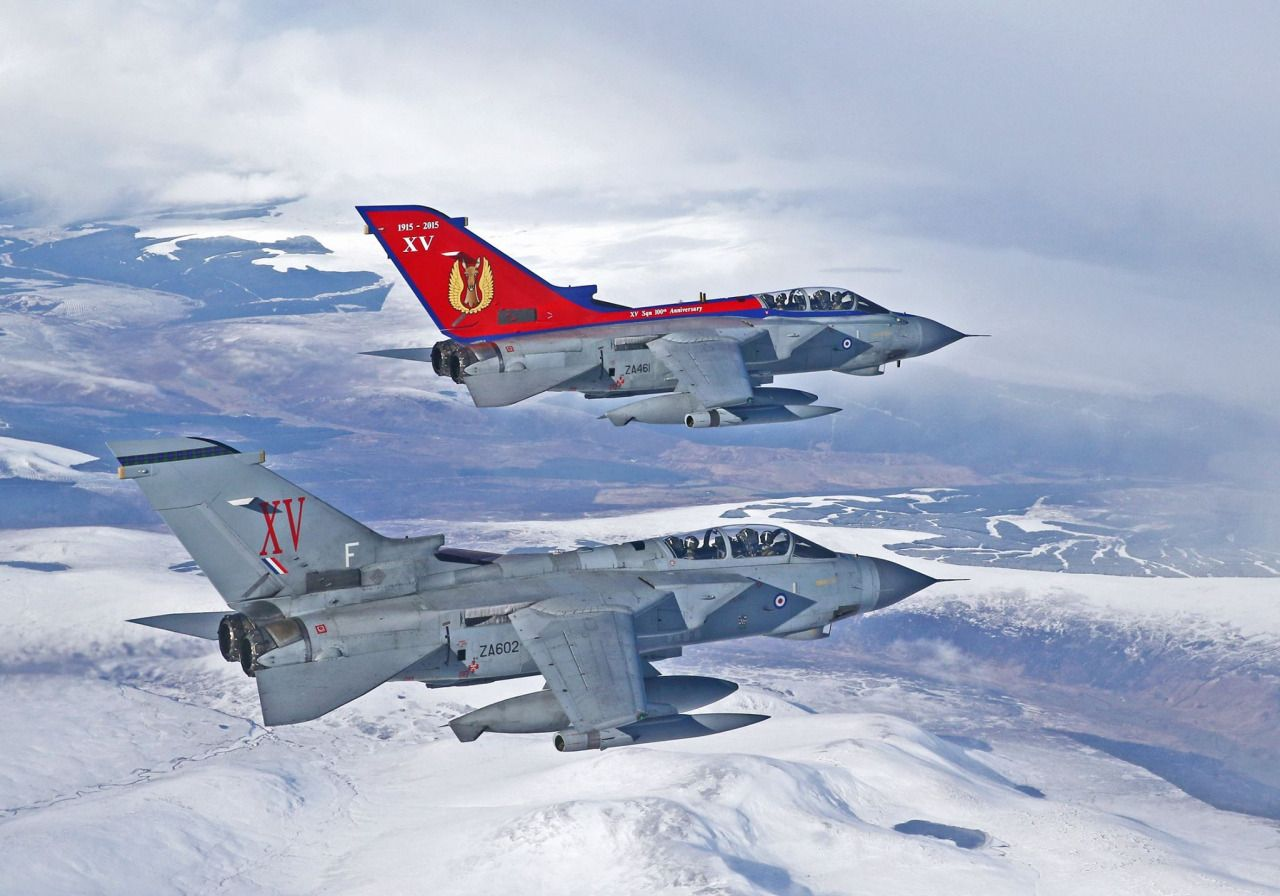 RAF XV (Reserve) Squadron Tornado GR4s unveil a special 100th anniversary paint scheme over the snowy peaks of the Scottish highlands.