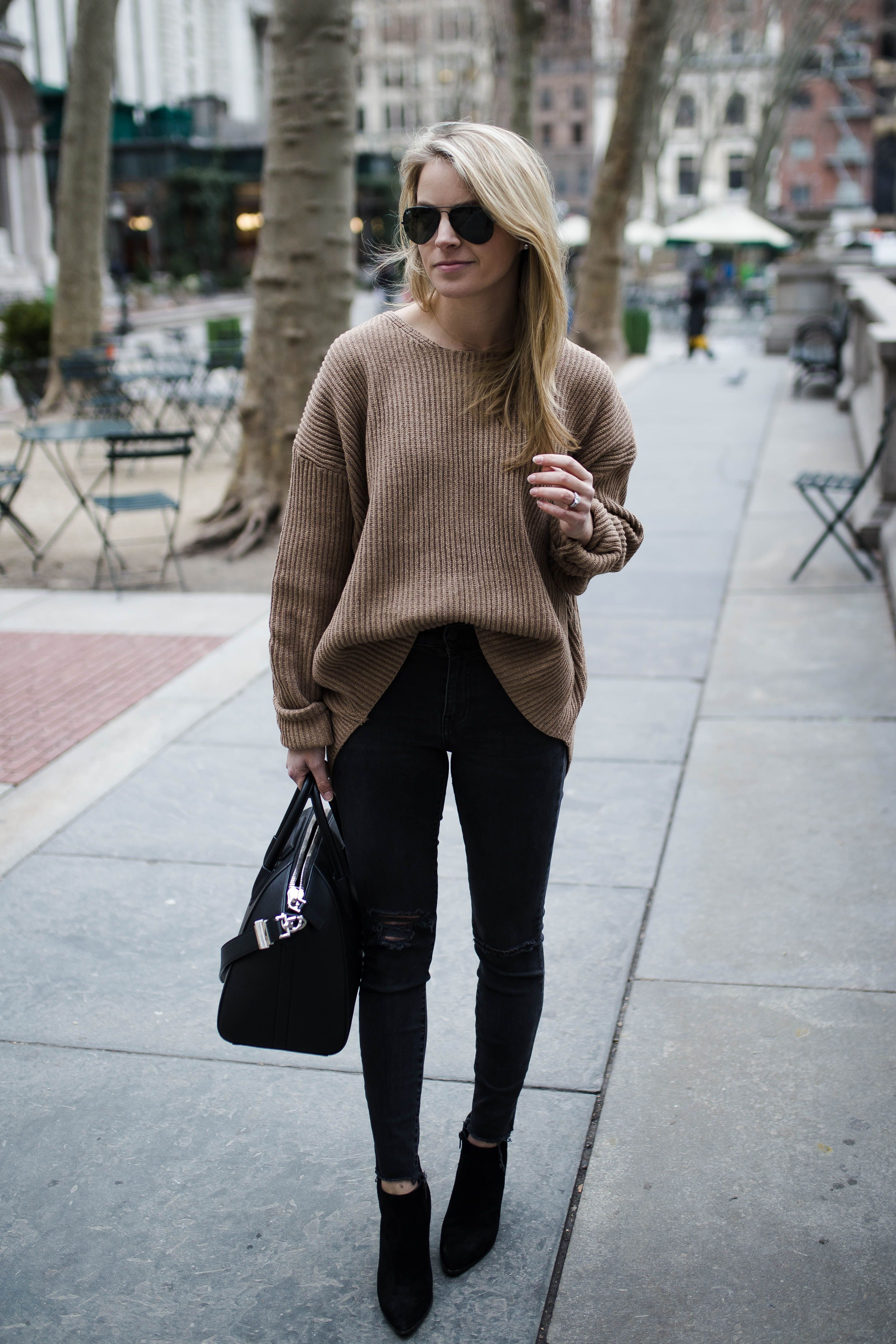 7173ebe5970 Oversized tan sweater + distressed skinny jeans + black suede booties