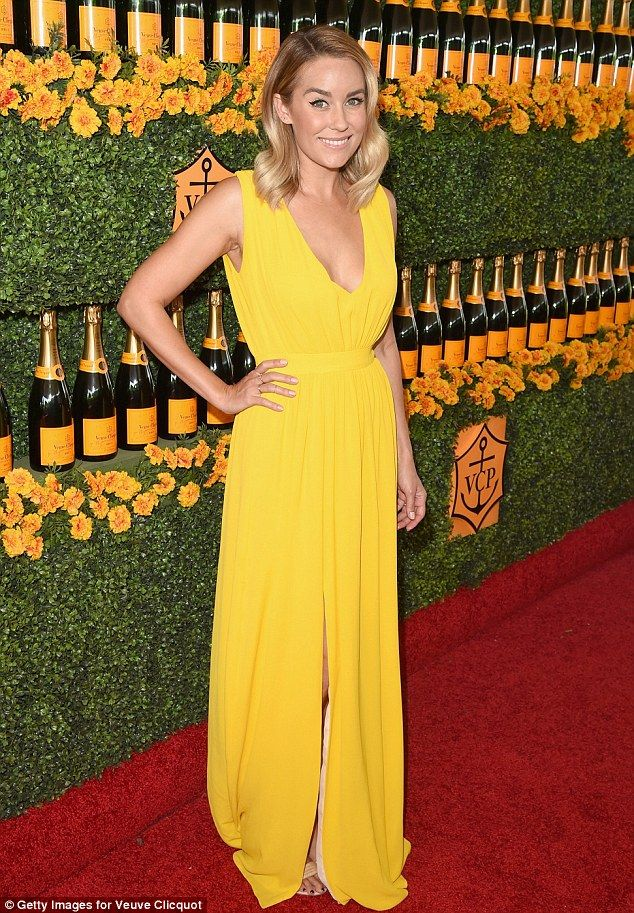 5abe4b5bf3 Glowing  The 29-year-old TV personality wore a vibrant yellow dress and her  blonde locks in soft waves