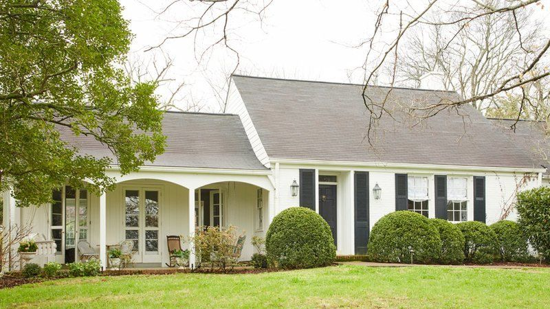 Prepare To Fall In Love With This White Colonial Revival In Oak Hill Tennessee House Exterior Colonial Revival Home Exterior Makeover