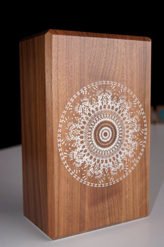 Yoga block hand made from walnut. The print is white representing a mandala. All the blocks are cover whit 3 layers of water varnish. rp0qU