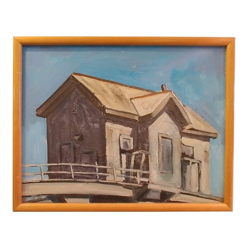 A small oil on canvas painting of a house like structure, perhaps a guard house on a jetty or pier. Simple wood frame measures 19