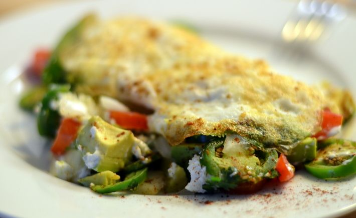 mexican egg white omelet served with jalapenos onions and goat cheese overflowing