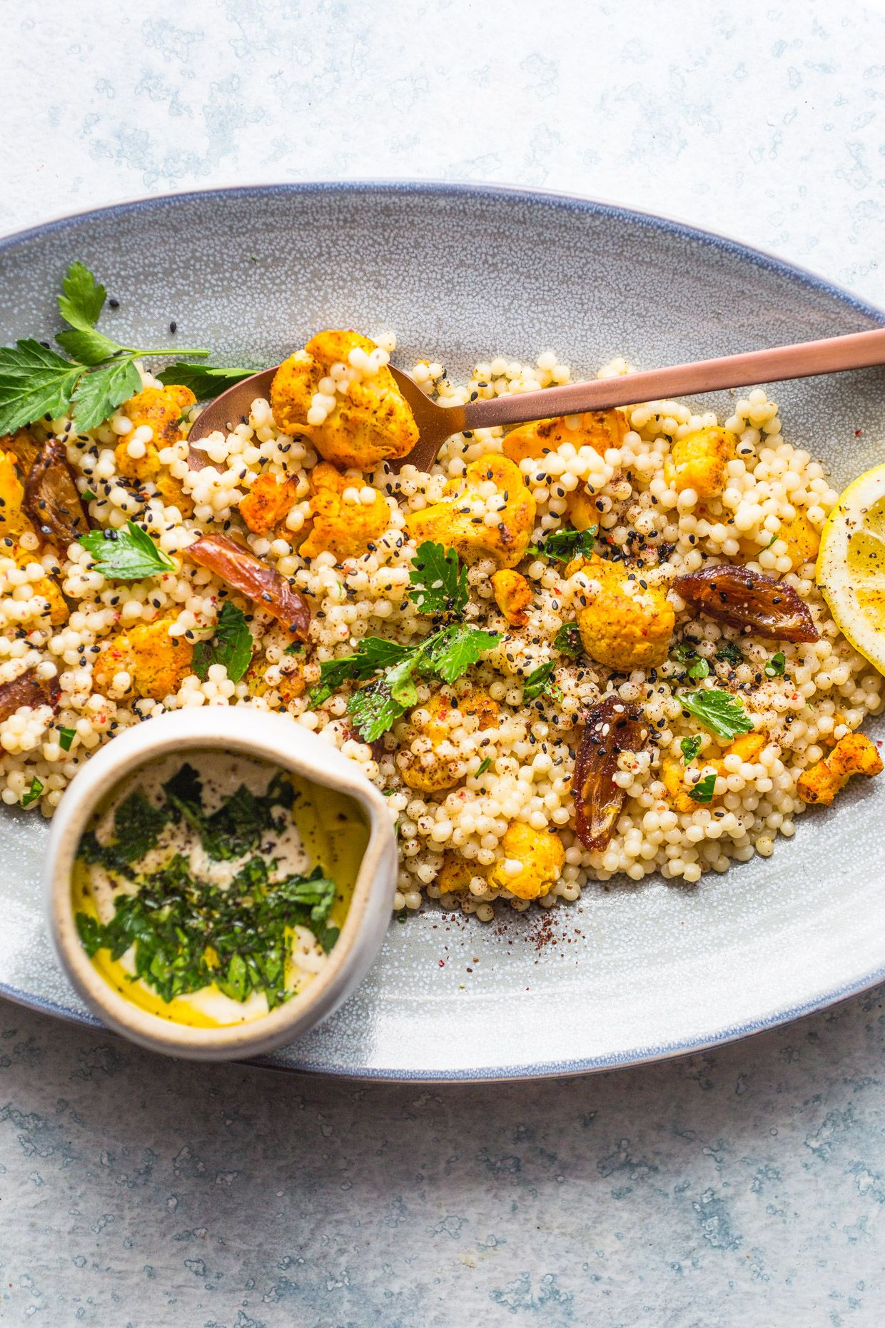 Roasted Cauliflower Dates Couscous Salad With Creamy Tahini