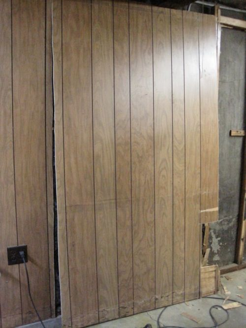 I cut around the electrical outlets when removing the wood paneling.  (cutting into & - I Cut Around The Electrical Outlets When Removing The Wood