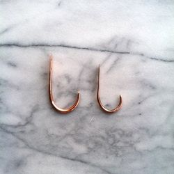 Big and little handmade copper hooks from Nick Lundeen