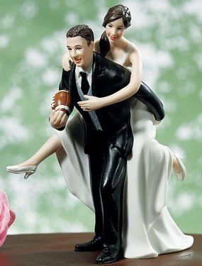"If you and your beloved are Football fans, you'll love this cake topper. Beautifully styled with exquisite detailing, this playful couple is destined to score a ""touch down"" on your big day.  Only $27.49 at Oasis Supply!"