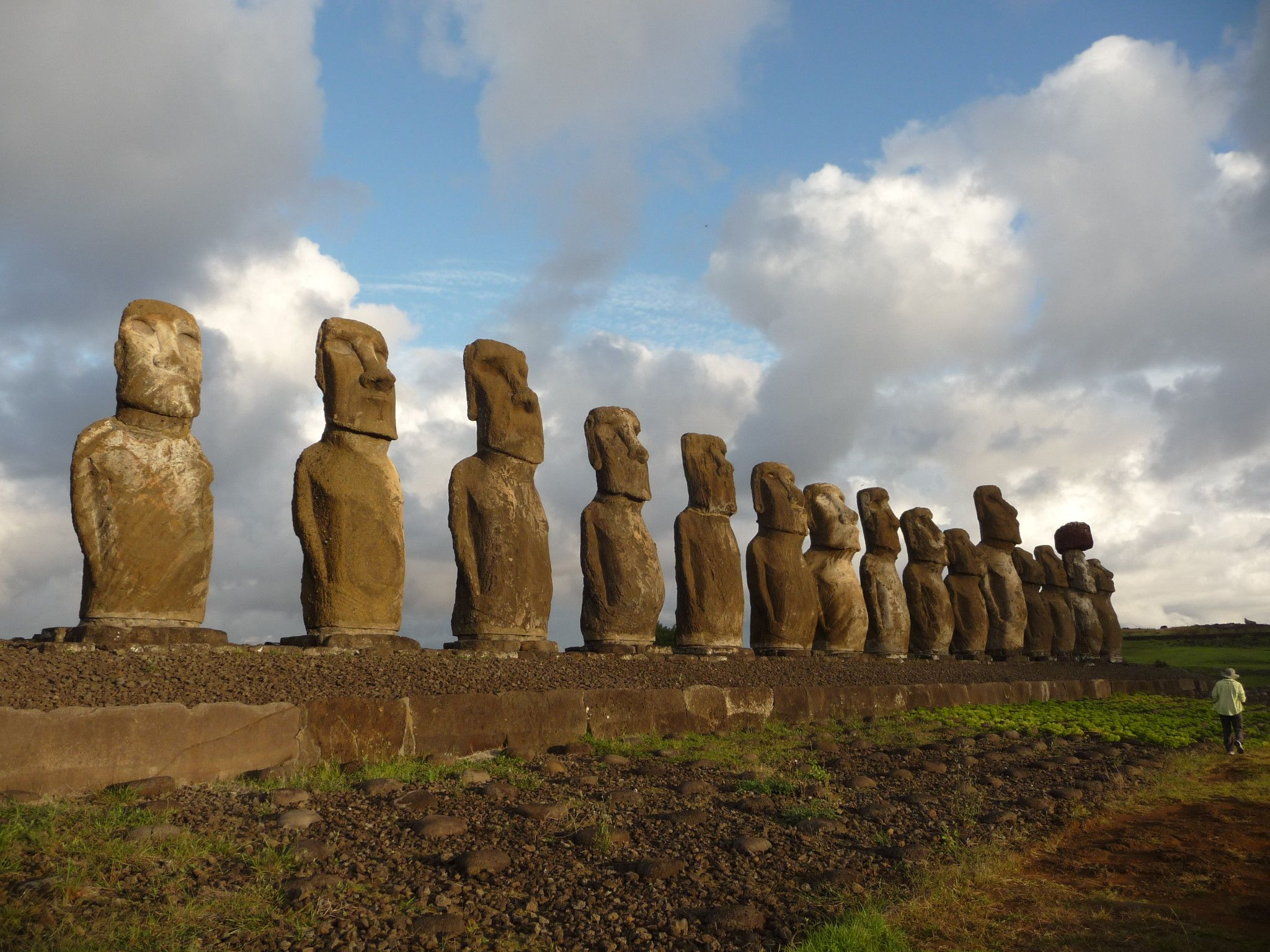 Man Photographing The 15 Huge Moai Statues Of Ahu