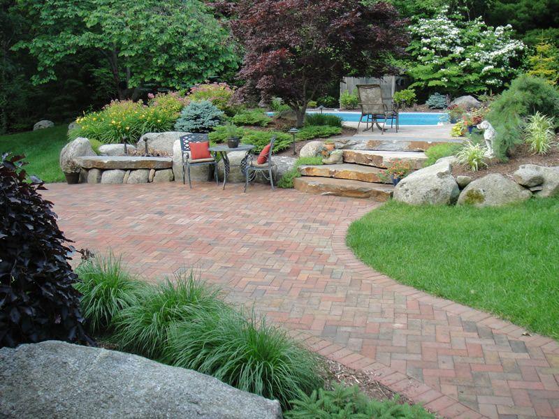 patios (02) clay brick patio and gardens around pool   back porch
